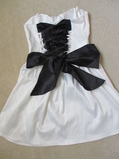 Replace the zipper on a dress with a ribbon back-great for too-small or too-big dresses!... love it!