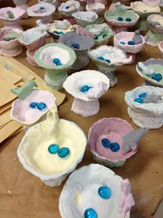 Splats, Scraps and Glue Blobs- clay bird bath with a blue glass marble melted in for water