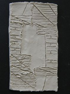 My porcelain slab with structures etched into it before firing