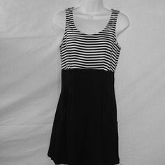 Size 7-8 Black And White Striped Romper This is an adorable romper that has black and white stripes on the top while the bottom is solid black. There are deep pockets on each of the sides and the romper zips up the back.  There are small belt loops around the waist so you can pair it with your favorite belt! This is size 7-8. Pants Jumpsuits & Rompers