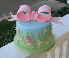 Fondant with floral cut outs and over-sized bow