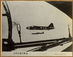 """Photograph captured in the Mariana Islands that shows a Japanese G4M Betty bomber. Item part of a scrapbook assembled by CDR William H. Balden, USNR, documenting his World War II service."""