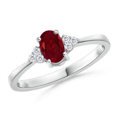 The ravishing centric garnet is held in a prong setting on the 14k white gold ring. Glimmering white diamonds flank the stunning gemstone and enhance its dynamic allure.  #mother