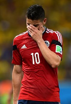 James Rodriguez of Colombia reacts after being defeated by Brazil 2-1 during the 2014 FIFA World Cup Brazil Quarter Final match between Brazil and Colombia at Castelao on July 4, 2014 in Fortaleza, Brazil.