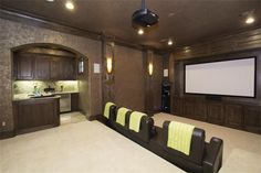 Nice in home theater room. Little kitchen off to the side.