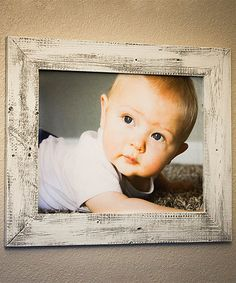 sweet baby pic framed in white washed barn wood
