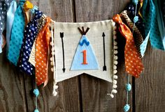 Adorable arrows and tribal inspired details make up this unique highchair banner. Can be made for any age & used as a high chair banner or wall decoration. Each banner is custom made just for you! Pennant measures approx 6x9 with 6 inches of designer trims on each side of the