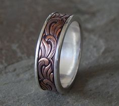 A perfect choice for the Art Nouveau lover. A Paisley ring!  Notice, the inside is all sterling silver, so the copper wont react with your skin. And
