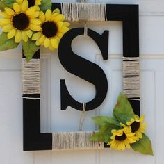 "This is a cute idea too Ma...NOT the yellow sunflowers though ;)  I love the letter ""G"" we could have on our front door and I like that its different than your typical wreath--its a picture frame with some twine....very simple but elegant!"