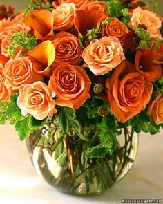 """Autumn Rose Arrangement"" This arrangement of calla lilies and roses is held in place thanks to a coiled grapevine. The orange of the flowers and the grapevine flower frog makes this the perfect arrangement for autumn. Artificial Flower Arrangements, Rose Arrangements, Artificial Flowers, Orange Flowers, Pretty Flowers, Autumn Rose, Flower Frog, Seasonal Flowers, Beautiful Roses"