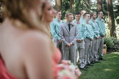 groom and wedding party watching as bride walks down the aisle during ceremony portrait by Matt Shumate Photography at the Evergreen Gardens in Ferndale WA teal, gray, coral, peach colors Wedding Shoot, Wedding Ideas, Evergreen Garden, Garden Weddings, Walking Down The Aisle, Peach Colors, Wedding Portraits, Walks, Groom