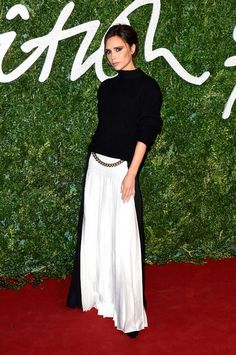 Victoria Beckham looking perfect in a maxi skirt and turtleneck