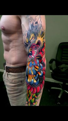 Contemporary colour Japanese sleeve, dragon & chrysanthemums done. ink, sleeve, full sleeve, colour, dragon tattoo, sick colours