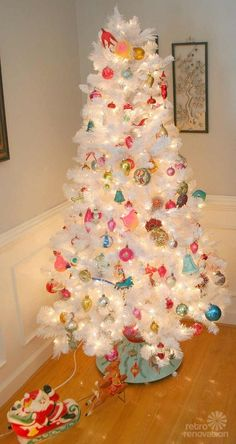 Fabulous pics of retro Christmas trees (in modern homes). This one is my favorite -- love the little Santa's sleigh on the floor, too!