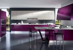 White And Purple Interior Kitchen Design With White Marble Coutertop And Purle Cabinets Also Grey Wall And Floor With Gas Stove And Washbasin