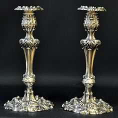 Pair of hollow sterling silver candlesticks with rococo decoration by John Watson, Sheffield, England c. 1820