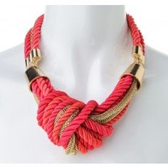 Update your look with this gorgeous coral and pink rope masterpiece! Pair this necklace with a white strapless maxi dress this season.