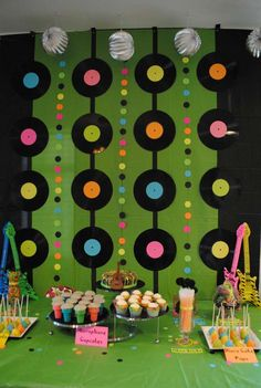 """switch up to pictures in large squares of twins and intersperse with little dr. seuss """"book covers"""" that we make on the inbetween colored dots (or whatever the inbetween lines are).: (decorating with rocks party ideas) 80s Birthday Parties, Music Themed Parties, Birthday Party Themes, 5th Birthday, 60s Party Themes, Birthday Backdrop, Birthday Ideas, Elvis Birthday Party, Hippie Birthday Party"""