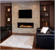 Stone with wall mounted electric fireplace for the basement family room. Living Room Tv, Living Room With Fireplace, Living Room Modern, Home And Living, Living Room Designs, Basement Fireplace, Fireplace Wall, Fireplace Design, Fireplace Ideas
