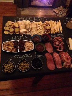 Wine and cheese party- awesome table display- chalk board serving table. Could be done with a serving board too