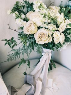 Romantic bridal bouquet, white roses, greenery, hand-tied, lightest pink & gray ribbons // Lissa Ryan Photography