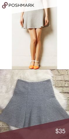 Anthropologie   Maeve  grey crosstown swing skirt Anthropologie   Maeve  grey crosstown swing skirt. Textured mini skirt wig exposed zipper. Aprox measurements are 19.5' length 16'waist and 19' hips. All over ribbed. Skirts Mini