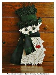 This little snowman made from repurposed puzzle pieces. SO many puzzles available at thrift stores.waiting for a new life like this. - would be a great family craft during christmas break Snowman Crafts, Crafts To Do, Christmas Projects, Holiday Crafts, Holiday Fun, Crafts For Kids, Puzzle Piece Crafts, Puzzle Art, Puzzle Pieces