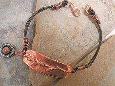Twigs bracelet cast in pure copper and finished with a leather cord and hematite charm