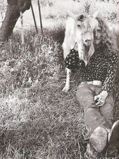 Robert Plant      countrydarlin:    A picture of Robert Plant with a goat…. made my day.