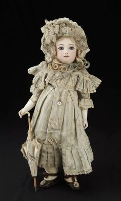 Beautiful antique, early, leather body, AT bisque head doll.