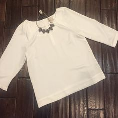 Scandal Collection off-white silky feeling blouse 100% polyester. Looser fitting top. Needs cami underneath. Cute silver bottoms on the sleeves and back. Goes great with a statement necklace! Worn once. The Limited Tops Blouses