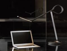 Let the Compasso LED Desk Lamp be the guiding light on your desk.
