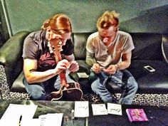 Brent and Zach changing strings. Shinedown