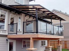 Covered patios and porches are a popular option for outdoor enjoyment as well. While the difference between a porch and deck is obvious, the differences between a deck and patio can be kind of blurred, especially decks that are built on the ground Patio Railing, Balcony Railing Design, Balcony Deck, Glass Railing, Deck Design, House Design, Glass Balcony, Metal Barn Homes, Metal Building Homes