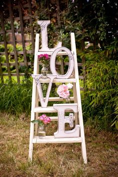 vintage-white-display-piece-made-with-white-ladder-pink-flowers-clear-jars-and-huge-letters.jpg (736×1103)