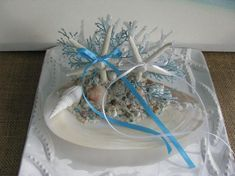 Items similar to Seashell starfish pearl beach wedding boutonniere bout looks like a rose on Etsy Beach Cake Topper, Beach Wedding Cake Toppers, Beach Wedding Decorations, Ring Holder Wedding, Wedding Rings, Seahorse Cake, Beach Wedding Boutonniere, Under The Sea Decorations, Starfish Ring