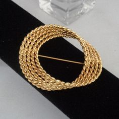 Vintage Monet Art Moderne Goldtone Styled Swirl Brooch that Measures 2 inches in Diameter. Listed at $20.00 Free Shipping to the United States. For today only you can get 10% off on your purchase. This promotion was good for the weekend. Have a great vintage day! Best, Coco