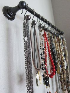 Using towel bars to organize jewelry.