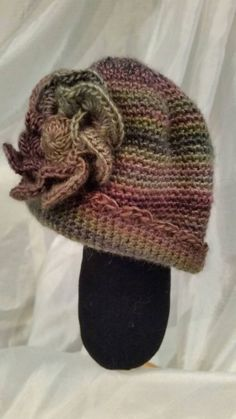 Crocheted hat for toddler girl with flower by LaceMarketKnits on Etsy