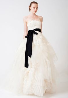 Add a black velvet bow to your wedding gown.