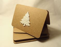 These simple but elegant trendy kraft paper Christmas cards have a pearly light…
