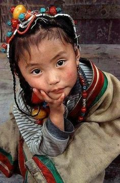 So very thoughtful, unusual in a child as small as she is. (From her jewelry I surmise - though it doesn't have anything to do with her thoughtfulness - that she's from Tibet.)