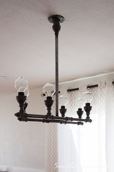 DIY Steel Pipe Light Fixture - this H-shaped light fixture is perfect for above a long dining table