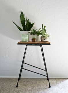 Vintage plant stand + pottery.  #midcenturymodern #plants