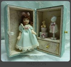 Dolls in boxes