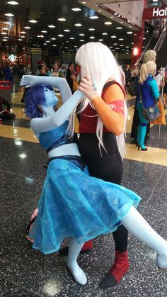 Lapis and Jasper from Steven Universe. Great cosplay, but the expression on Lapis face needs to be different.