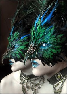 Exotic mask using colorful bird feathers.