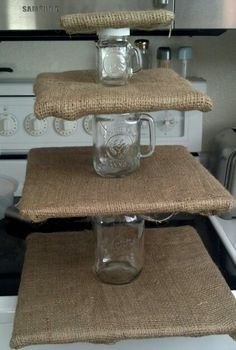 Burlap and Mason jar cupcake stand. There I no link for this, but I know that Ben could figure something out Rustic Cupcake Display, Rustic Cupcake Stands, Cupcake Stands For Weddings, Wedding Cake Rustic, Rustic Cake, Our Wedding, Wedding Ideas, Wedding Sweets, Wedding Cupcakes