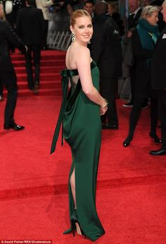 Chic: The actress exuded elegance in a strapless emerald gown, which was given an offbeat twist thanks to a flirty open back