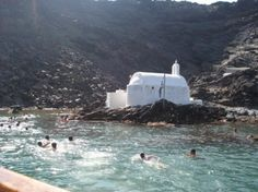 The hot springs in Santorini, Greece, are volcano-heated. The best hot springs are on Nea Kameni and Palaia Kamen, tiny uninhabited islands. Photo by Mega Travel Advisor Greece Cruise, Santorini Greece, Natural Baths, Trip Advisor, Travel Advisor, Century Hotel, Travel Words, Hot Springs, Places To See